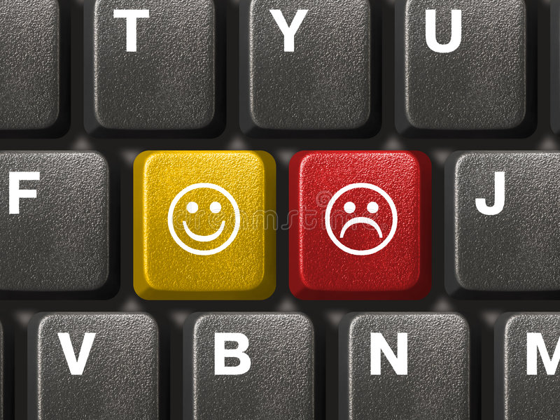 Computer keyboard with two smiley keys. Computer keyboard close-up with two smiley keys (emoticons royalty free stock images
