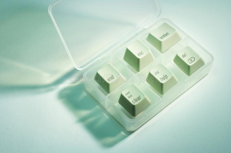 Computer Keys in Plastic Case. With Green Cast royalty free stock photography