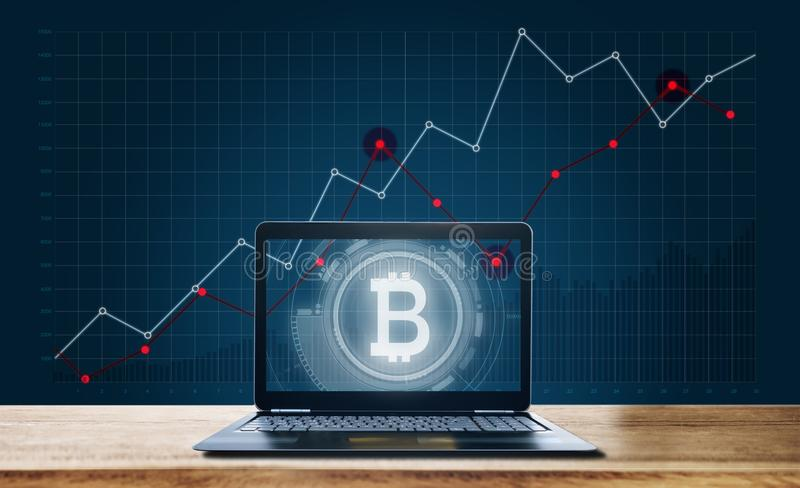 Computer laptop and B Alphabet symbol of Internet banking, Bitcoin, and block chain technology on screen with raising graph backgr stock photos