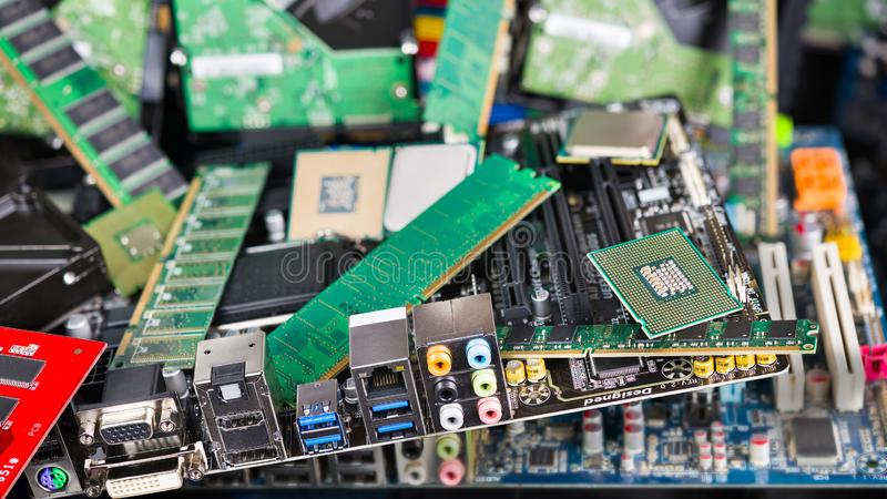 Computer and laptop cards. Mainboards, chips and memories. Pile of new obsolete PC parts. CPU, PCB, RAM, DIMM, connectors, slots, capacitors. Electronic waste stock photos