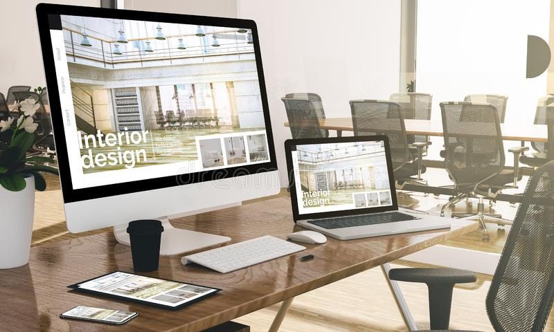 computer, laptop, tablet, and phone with interior design website at office mockup stock image