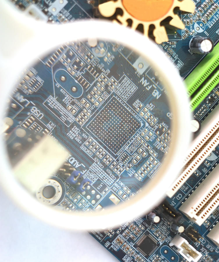 Computer Mainboard Under Magnifying Glass Stock Image