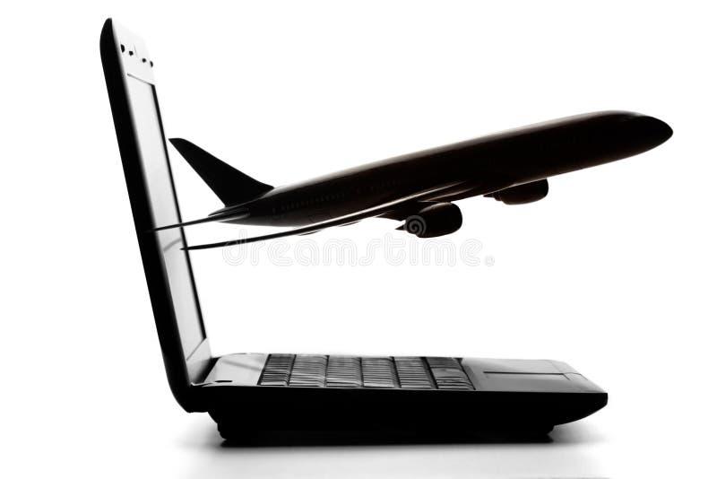 Computer met vliegtuigen royalty-vrije stock foto's