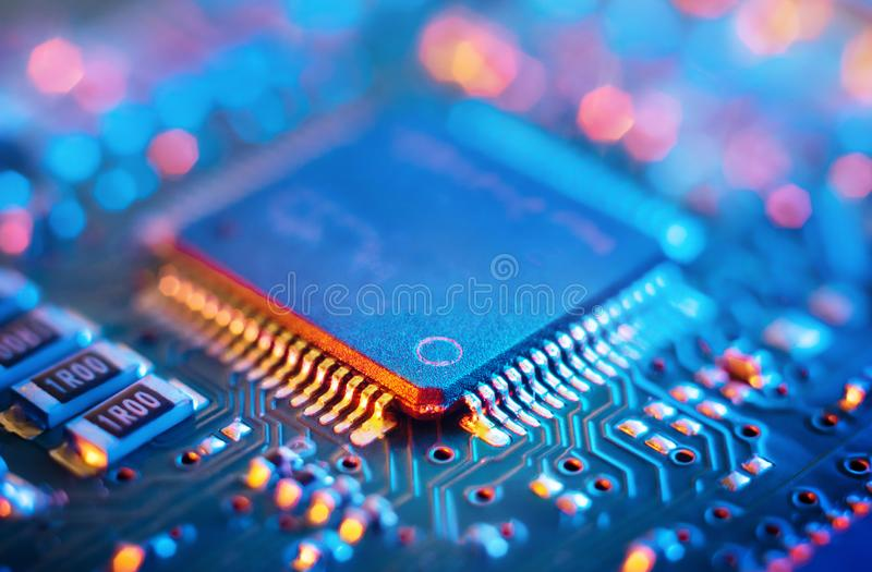 Computer Microchips and Processors on Electronic circuit board. Abstract technology microelectronics concept background. royalty free stock image