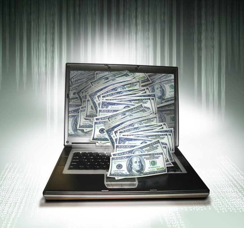 Computer money. A graphite PC laptop with money spilling from the monitor. Concept for global ecomomy via the internet
