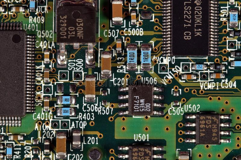 Computer motherboard Close Up. Macro shot of a Circuit Board with electronic components. old Computer hardware technology. Processor. Information engineering royalty free stock image