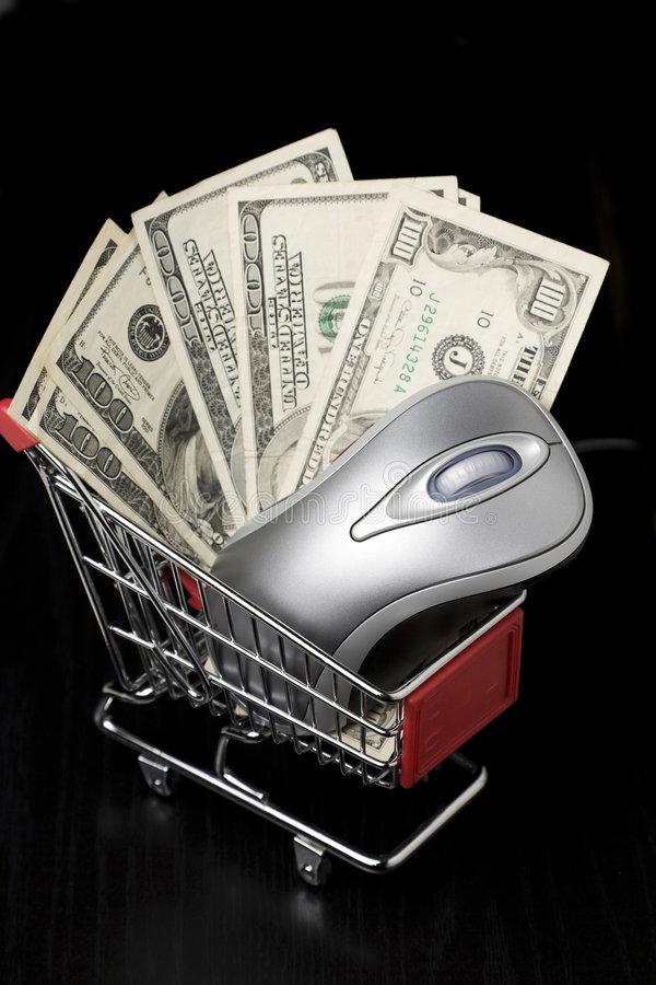 Computer Mouse And $100 Dollar Bills In A Shopping Royalty Free Stock Photography