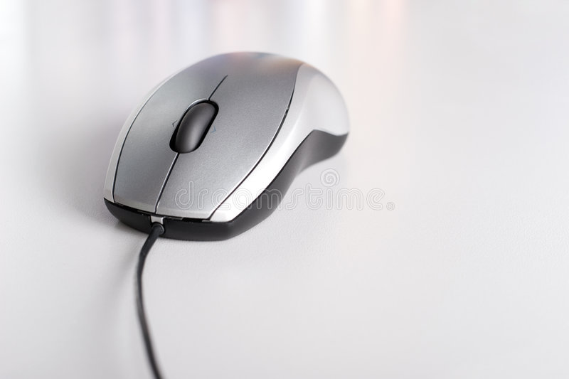Computer mouse on gray background royalty free stock photography