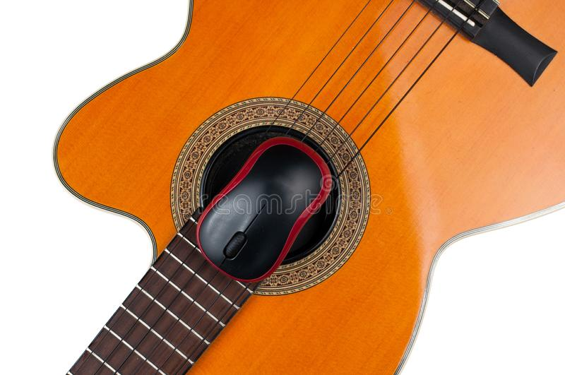 Computer mouse and guitar isolated on white background. Music, electronics, headphones, sound, screen, keypad, office, remote, laptop, plucking, instrument stock images