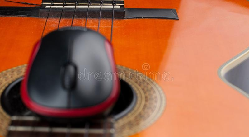 Computer mouse and guitar isolated on white background. Music, electronics, headphones, sound, screen, keypad, office, remote, laptop, plucking, instrument stock photos