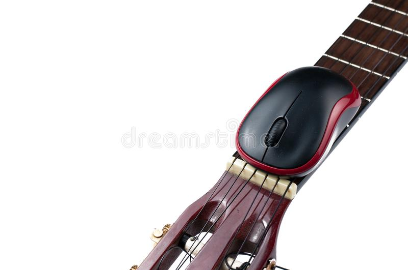 Computer mouse and guitar isolated on white background. Music, electronics, headphones, sound, screen, keypad, office, remote, laptop, plucking, instrument stock image