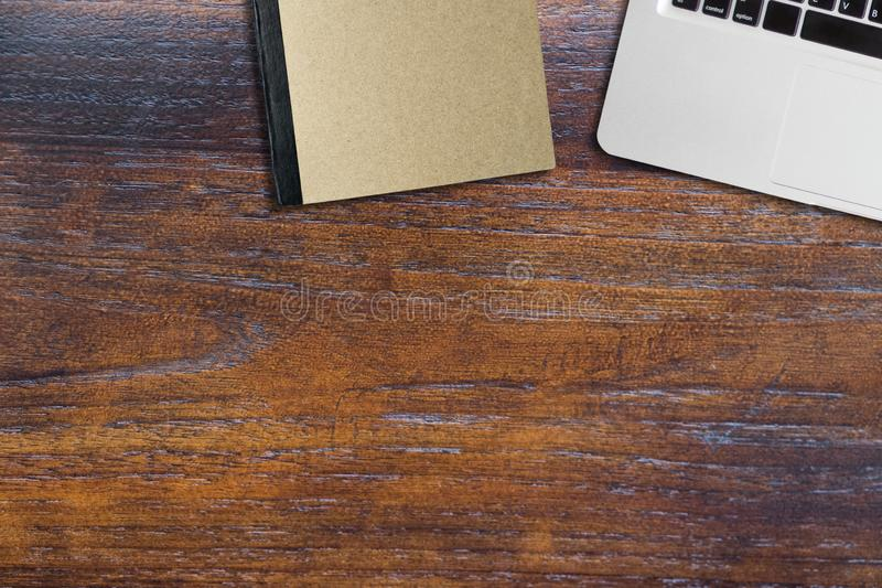Computer note book and book on wooden table. Copy space royalty free stock images