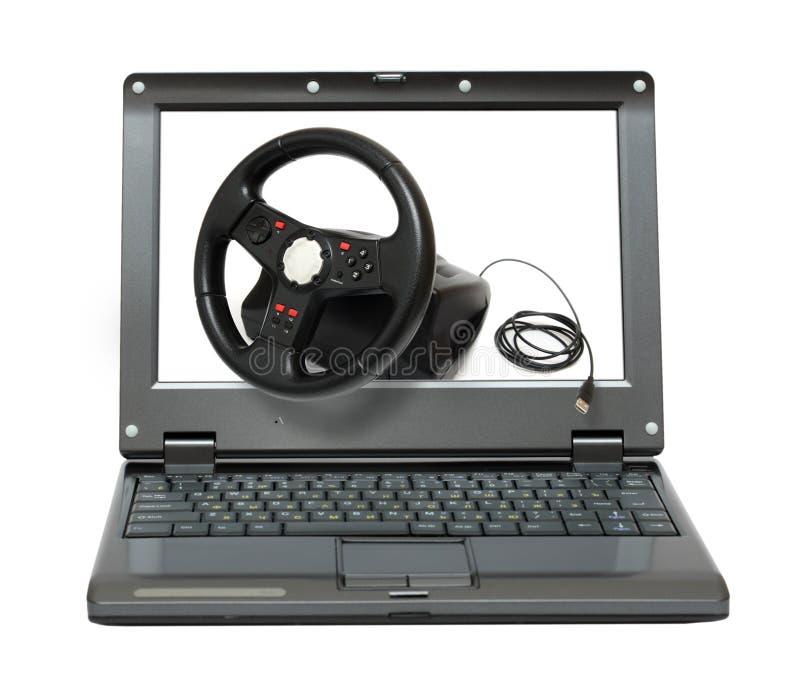 Computer portatile con il simulatore dell'automobile di gioco fotografia stock