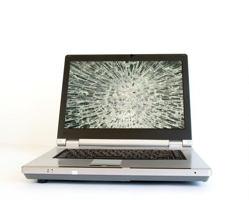 Computer portatile con il video rotto dello schermo fotografia stock