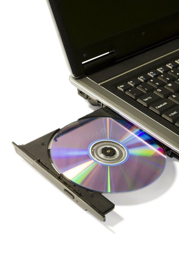 Computer portatile con l'azionamento caricato di DVD fotografia stock libera da diritti