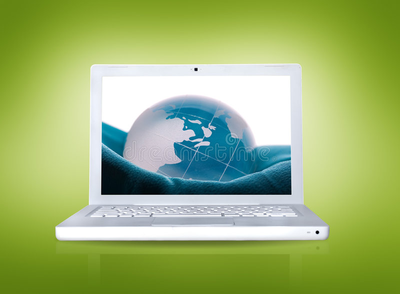 Computer portatile con la maschera del globo fotografie stock