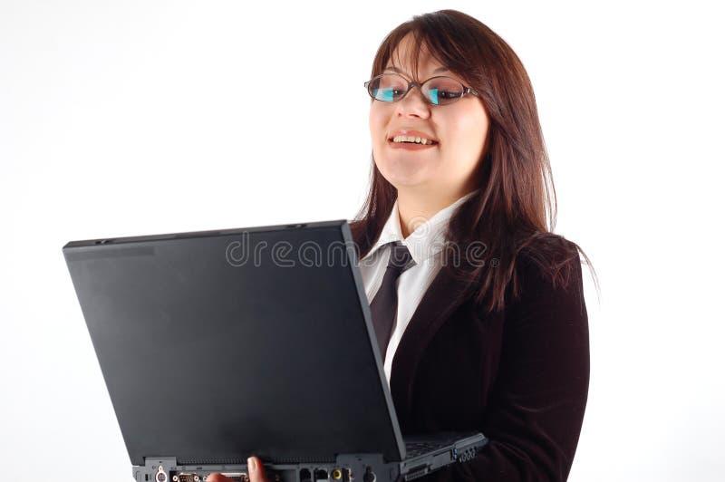 Computer portatile della holding della donna di affari fotografie stock