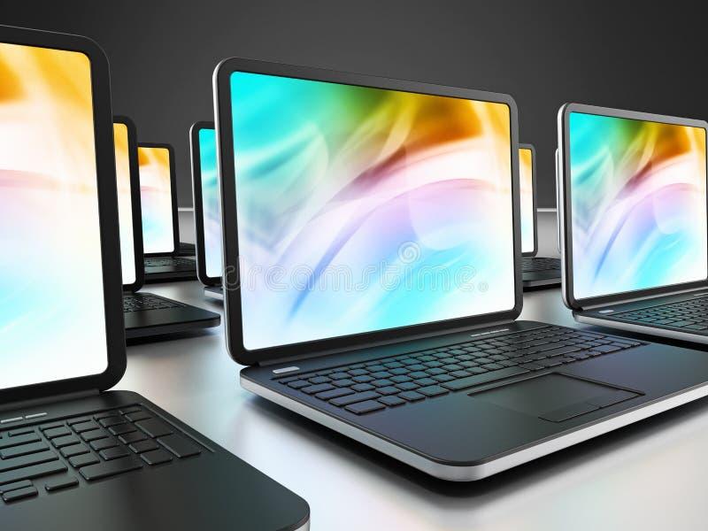 Computer portatili in una fila fotografia stock