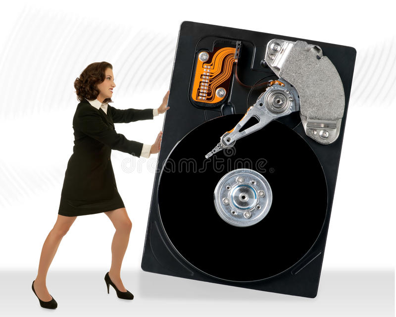 Computer Problems. Young attractive business woman moving a hard drive stock photos
