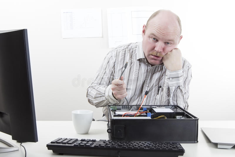 Computer Problems. Office worker / businessman with lose computer cables stock images