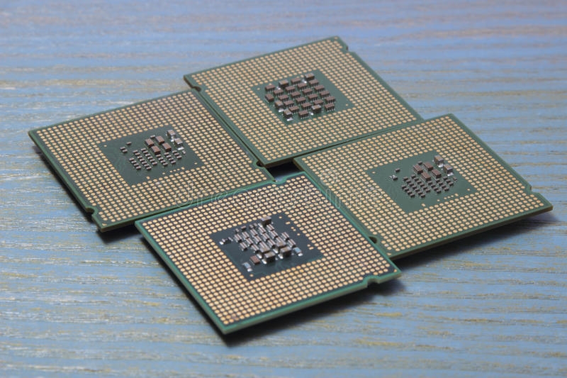 Download Computer Processor On A Wooden Background Stock Photo - Image of digital, chip: 83709502