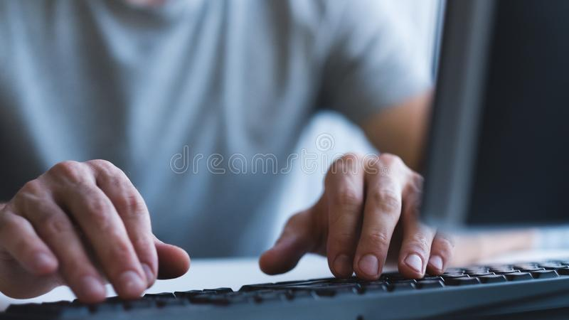 Computer programming coder keyboard typing. Computer programming. Coder at work. Closeup of male hands using keyboard, typing. Copy space royalty free stock images