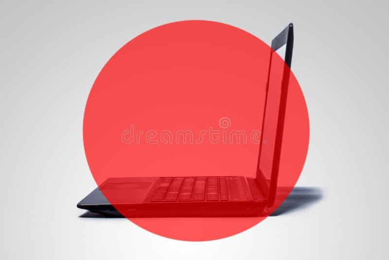 A computer with a red, transparent circle. stock photos