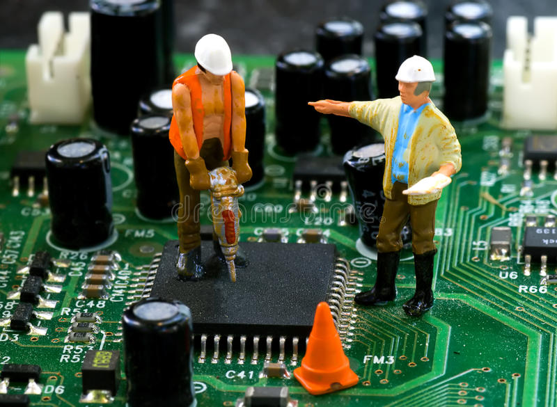 Computer Repair. Concept with N scale construction workers