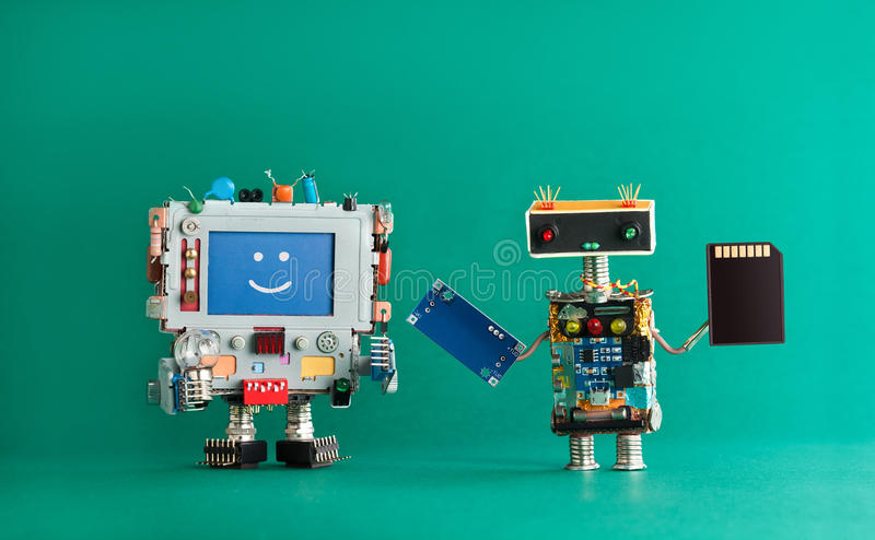 Computer repair renovation concept. Smiling monitor machine, robot serviceman with chip circuit storage memory card stock images