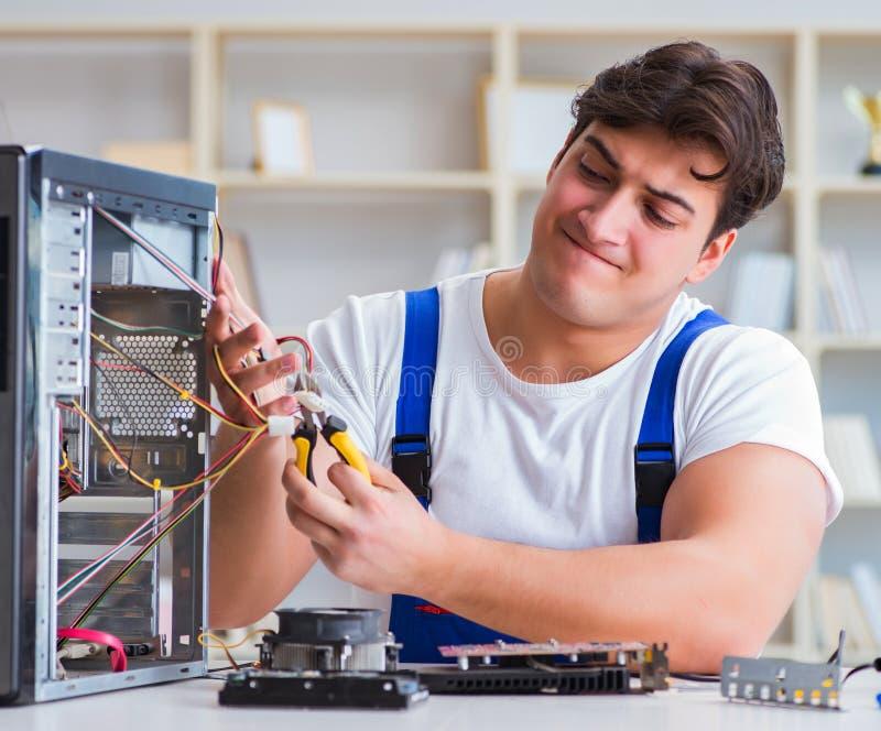 Computer repairman repairing desktop computer. The computer repairman repairing desktop computer stock photos