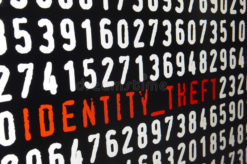 Computer screen with identity theft text on black background stock illustration