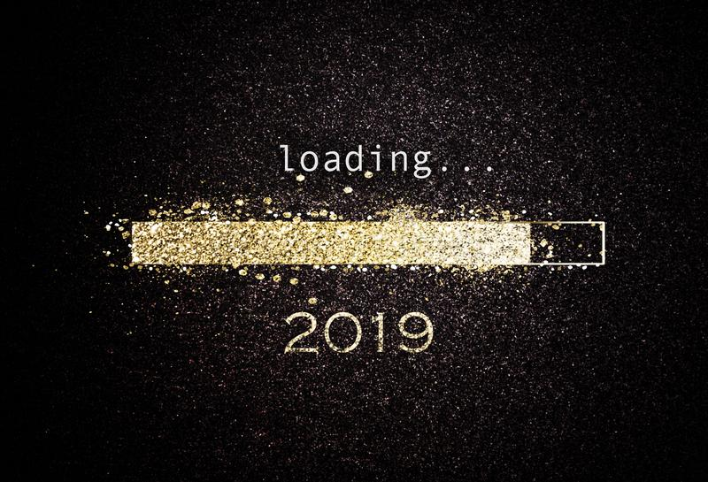Computer screen with loading bar for 2019. Computer screen with loading bar counting down for New Years Eve 2019 with sparkling glitter and copy space over black vector illustration