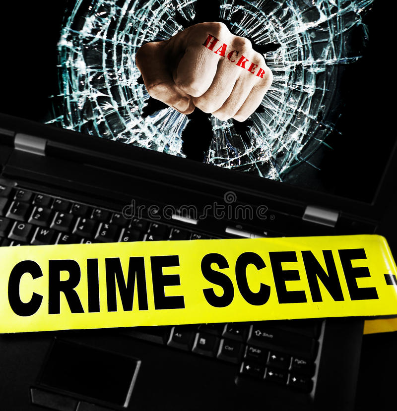Computer security breach. Hacker fist on laptop screen with crime scene tape stock images