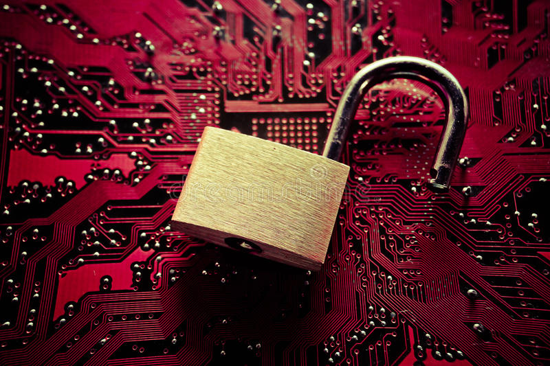 Computer security breach. Unlock security lock on computer circuit board - computer security breach concept royalty free stock photography