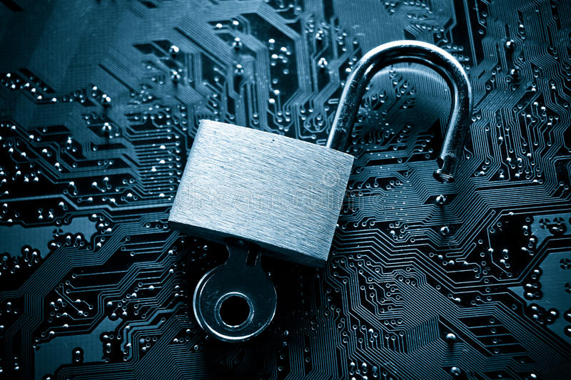 Computer security breach. Unlock security lock on computer circuit board - computer security breach concept royalty free stock photos