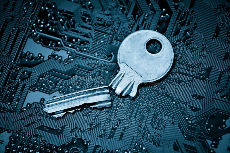 Computer security. A broken key on computer circuitboard background / computer security breach concept royalty free stock image