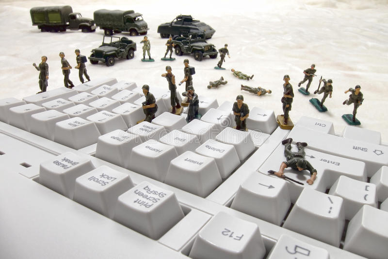 Computer Security Cyber Attack by Toy Soldiers royalty free stock photography