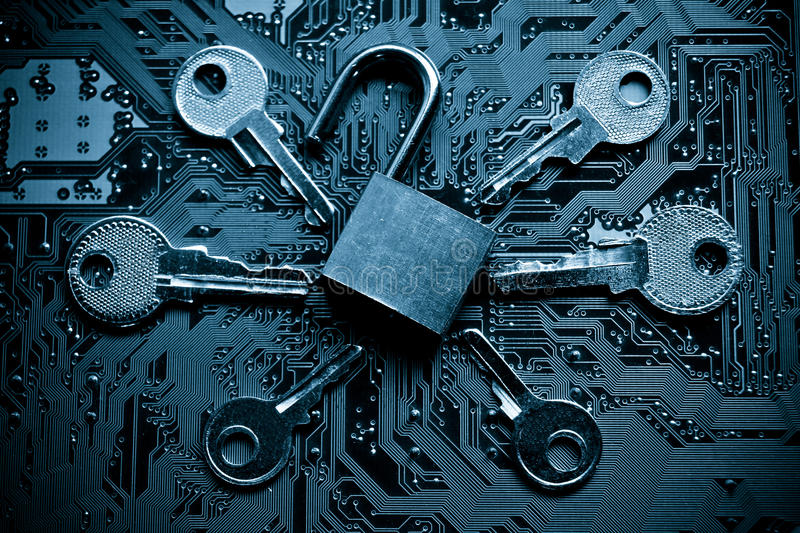 Computer security. A security lock on a computer circuit board surrounded by keys / random password hacking concept royalty free stock images