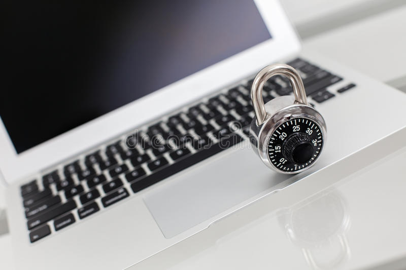 Computer security. A lock on a luxury laptop - concept of security stock image