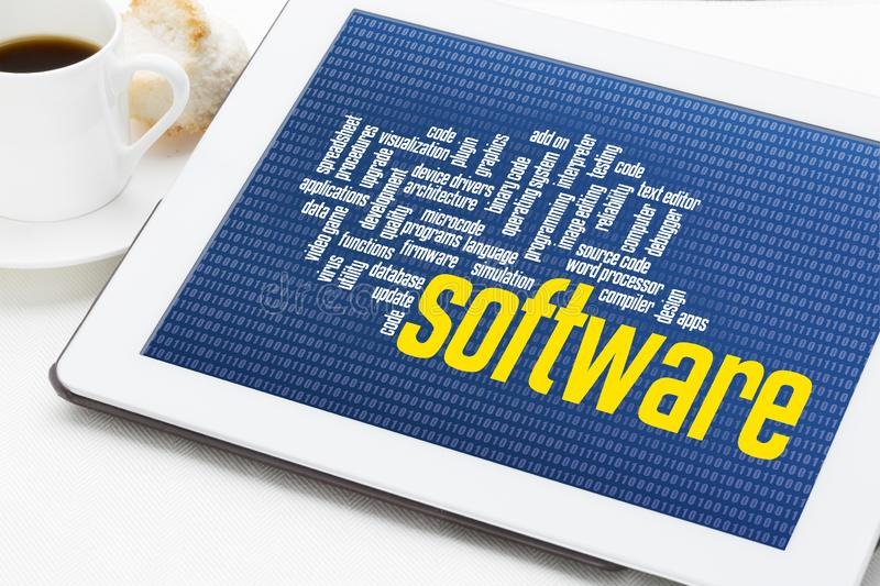 Computer software word cloud on tablet. Computer software word cloud on zero one binary background - digital tablet with a cup of coffee royalty free stock images
