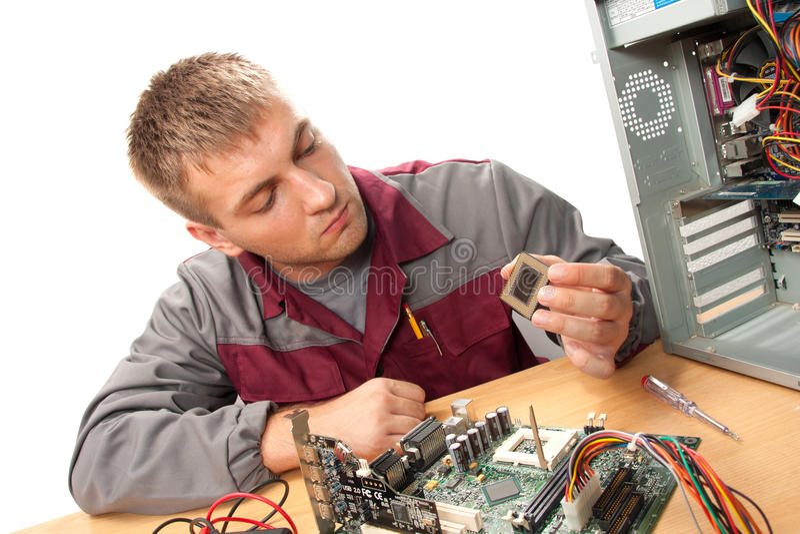 Computer support engineer. Installing processor stock photo
