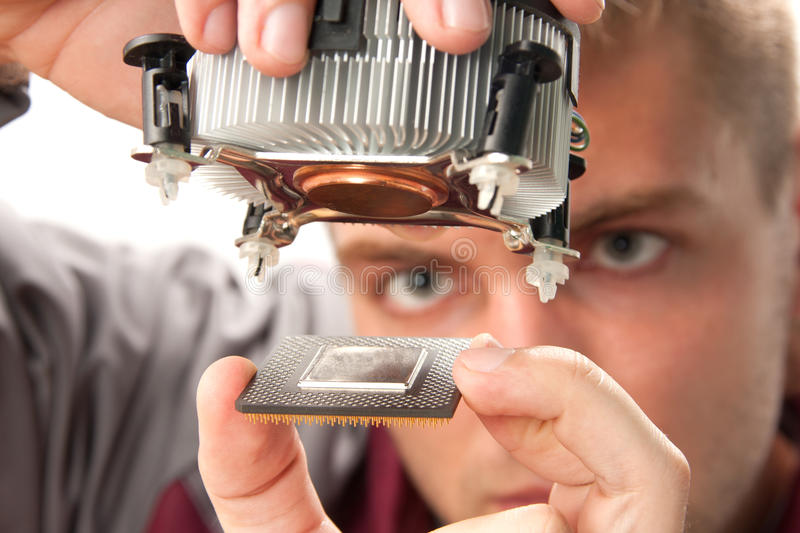 Computer support engineer. Installing processor stock photography