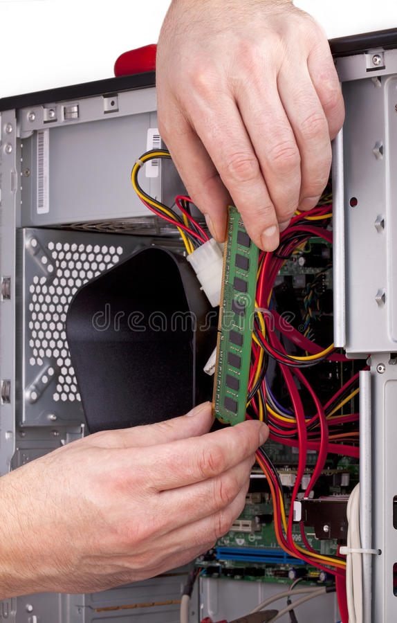 Computer support engineer. Studio-shot of a computer support engineer upgrading the RAM ( Memory) chip of an office computer,isolated on white stock photos