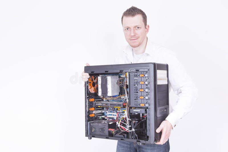 Computer support engineer. Holding an office Computer for upgrading it. Studio shot on a white background stock images