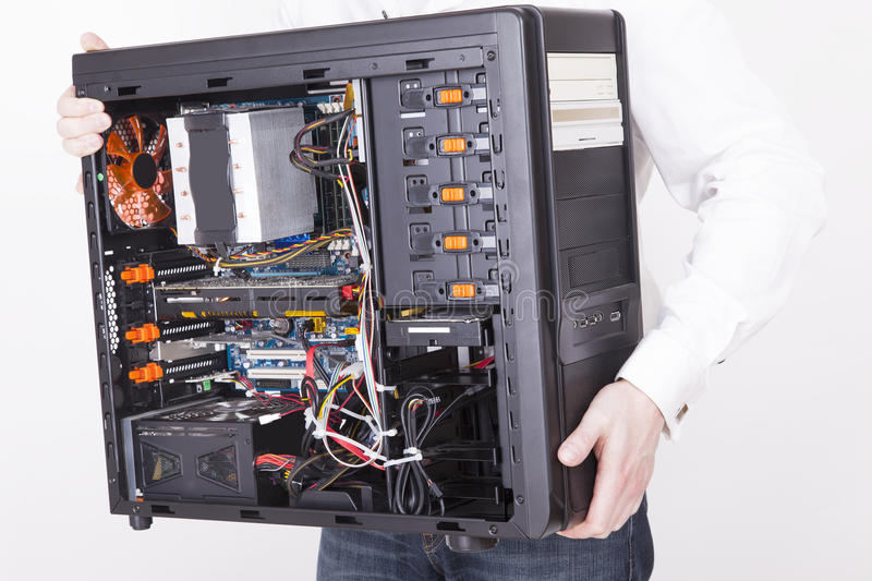 Computer support engineer. Holding an office Computer for upgrading it. Studio shot on a white background stock photos
