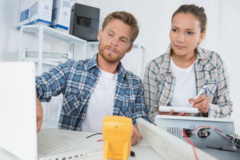 Computer it support team. Workers stock image