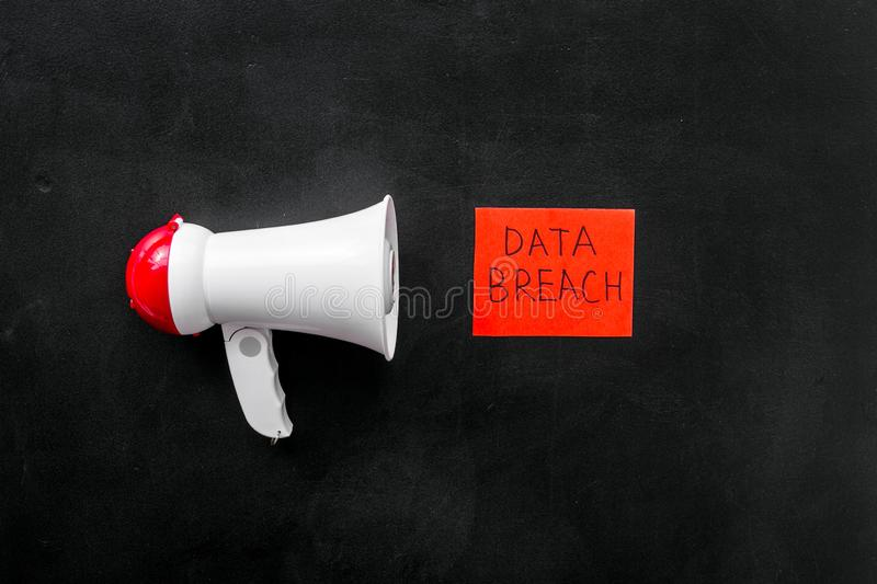 Computer system protection from hacker with data breach copy and speaking trumpet on black background top view stock images