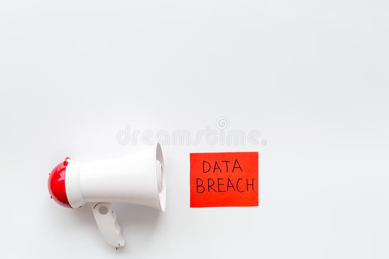 Computer system protection from hacker with data breach copy and speaking trumpet on white background top view mockup. Computer system and internet protection stock photos