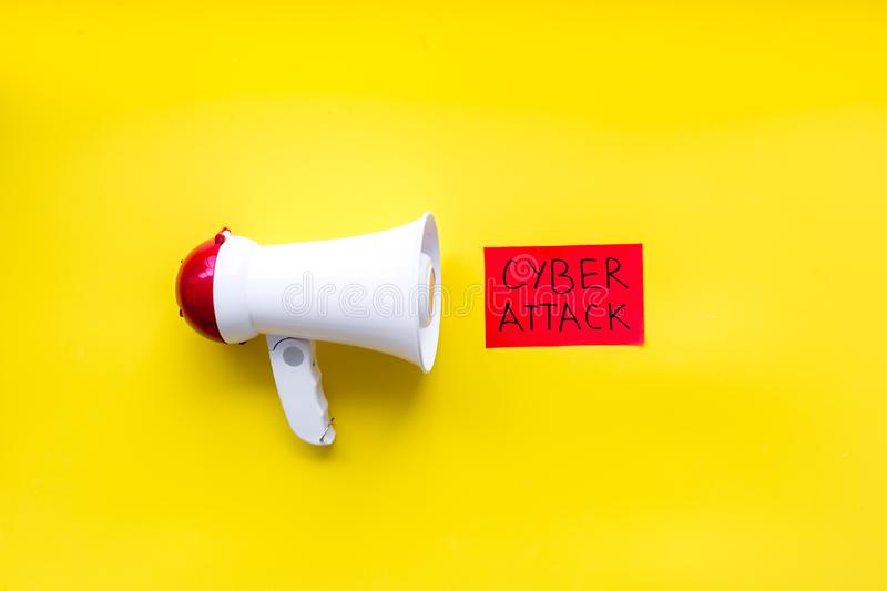 Computer system protection from hacker with data breach copy and speaking trumpet on yellow background top view royalty free stock images