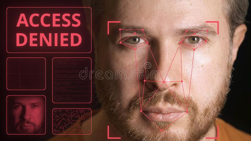 Computer system scans man`s face and can`t identify person. Access denied stock photos
